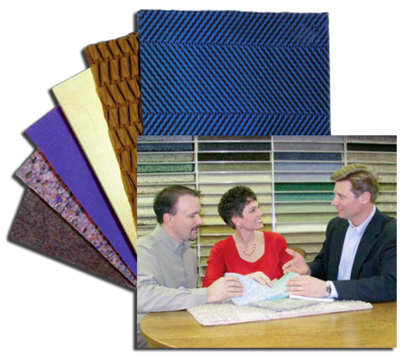 Salesman with Couple looking over samples of Carpet and Cushions